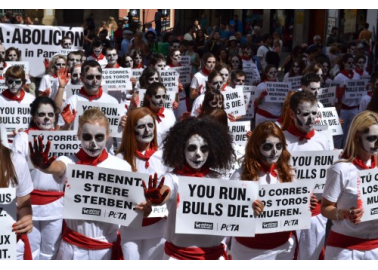 PHOTOS: 100 'Death Runners' Take Over Pamplona