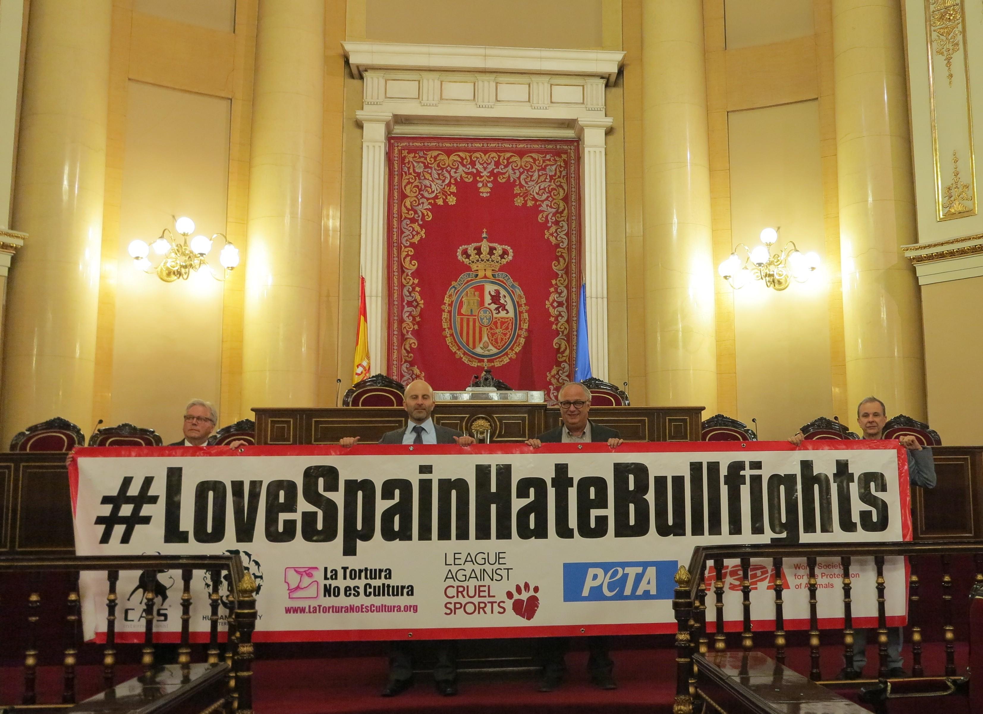 Love Spain Hate Bullfights banner in Spanish Senate
