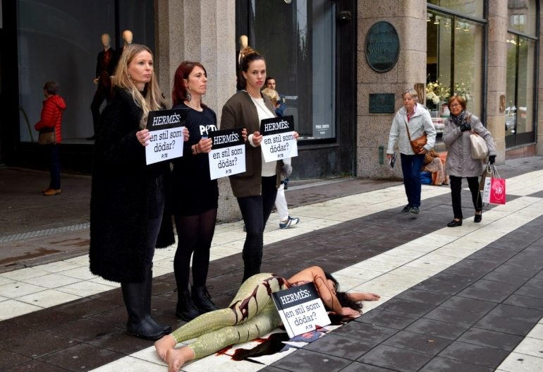 PETA protest outside Hermes in Stockholm, Sweden over alligator and crocodile cruelty