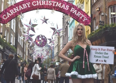 Santa's Little Helper Has a Message for Carnaby Street Shoppers
