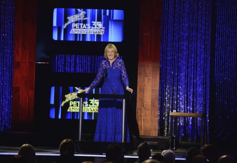 Ingrid E. Newkirk on stage at PETA's 35th Anniversary Gala.