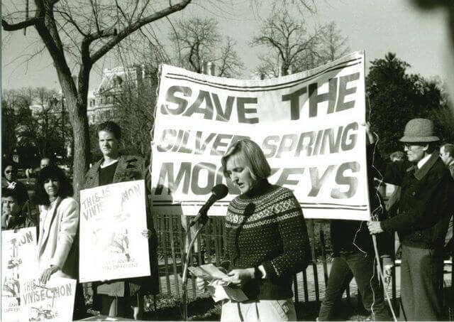 Ingrid with save the monkeys banner