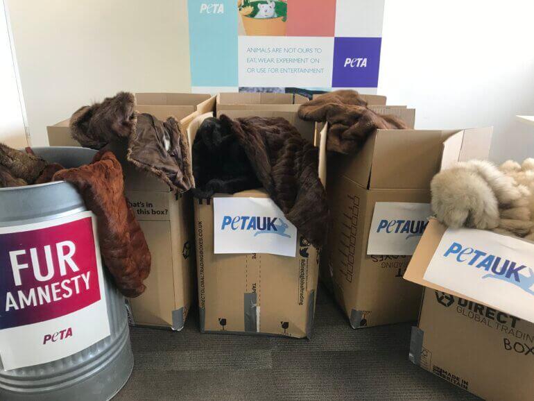 Boxes full of fur coats